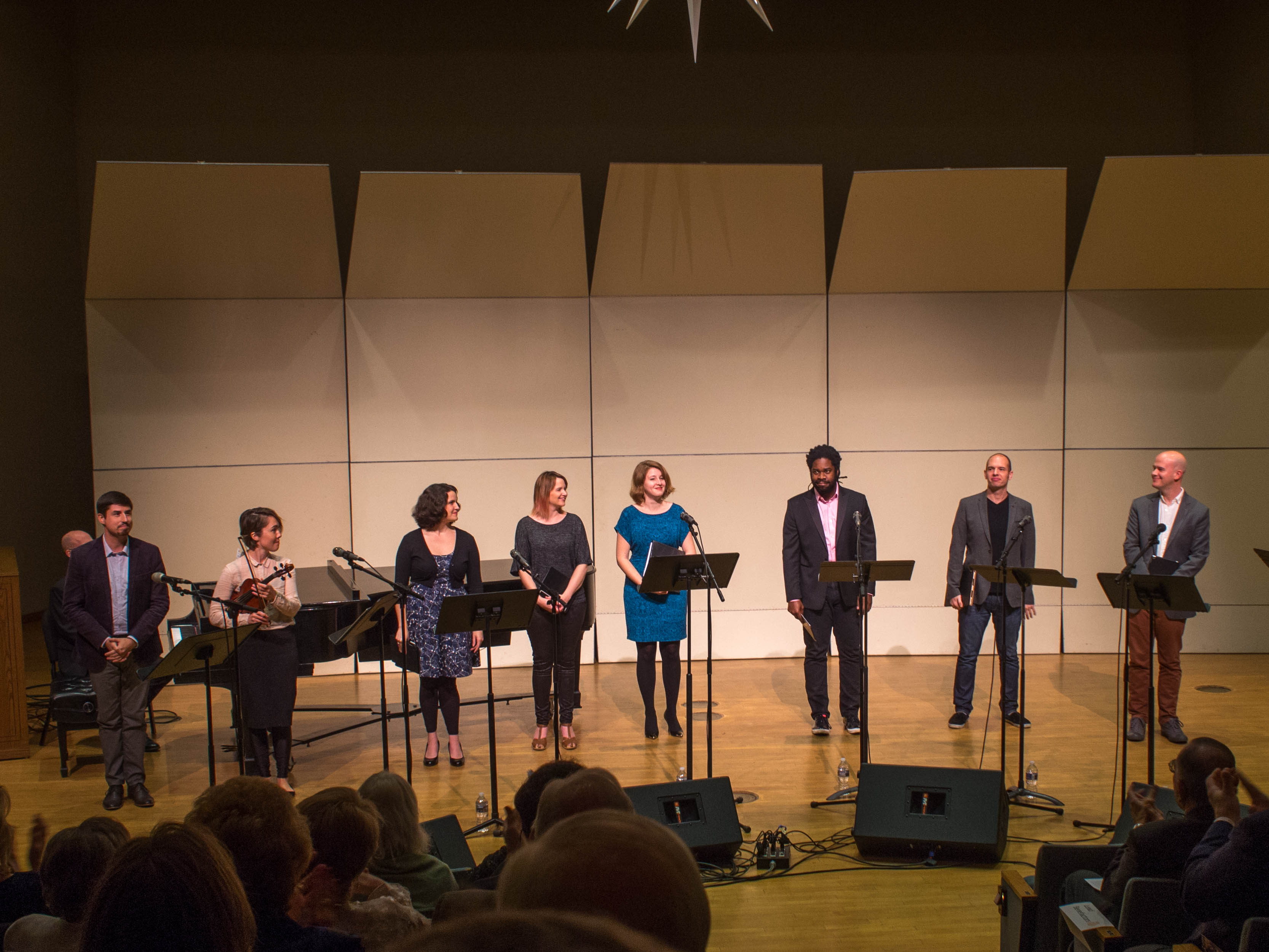 Bach Choir favorite, Dashon Burton (third from the right), receives applause for his Bach aria.  The prodigiously gifted composer, singer, and instrumentalist, Caroline Shaw, is holding her viola.